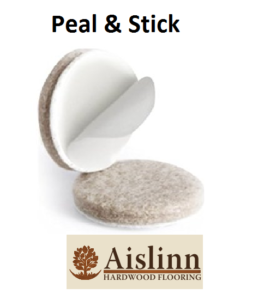 Image of circular furniture protection pad displaying the peel off back by which means they are fitted to furniture